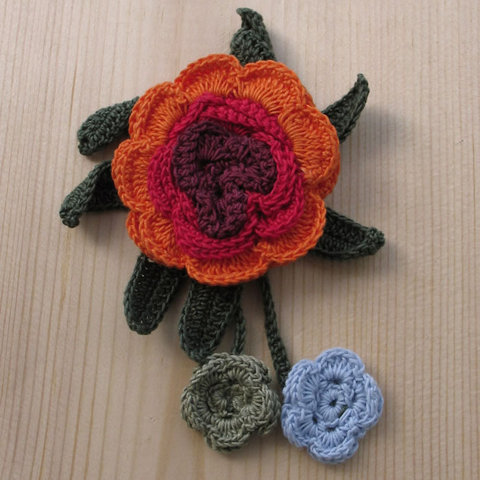 Crochet pin flower brooches